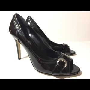 Enzo Angiolini open toe slip on stiletto heels.